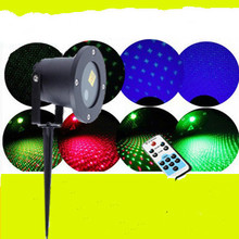 Outdoor waterproof laser laser puckering Remote control red green all over the sky star Garden lawn lamp plugged in Christmas
