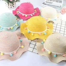 Nueva moda de verano de los niños sombreros de paja colorido borla bolas  bebé niña playa d270d237485