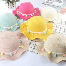 aa8dcdd247fae Nueva moda de verano de los niños sombreros de paja colorido borla pelotas  de playa gorra