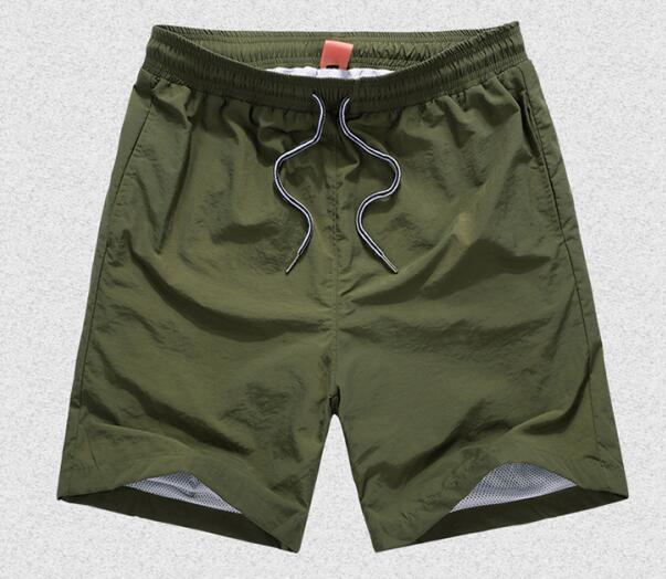 Men Breathable Mesh Fabric ShortsSummer FashionSolid Men ShortsCasual Beach Shorts Joggers Trousers