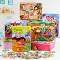 O envio gratuito de 100 lata de madeira enigma de madeira do bebê e das crianças jovens brinquedos educativos para a primeira infância força 3-10 anos de idade presente