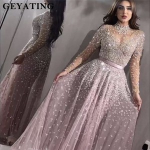 Image 1 - Роскошное вечернее платье с длинными рукавами 2020, расшитое бисером, с высоким воротником, женские платья для особых случаев, сексуальные прозрачные вечерние платья с круглым вырезом