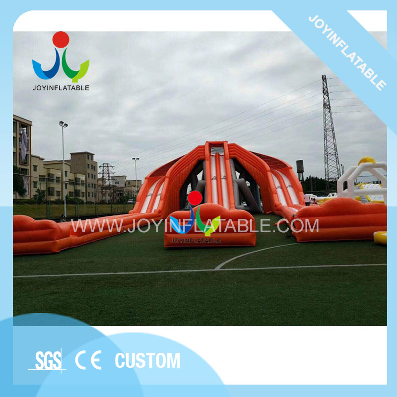 Giant amusement park inflatable long water slip slide with flame retardant for sale