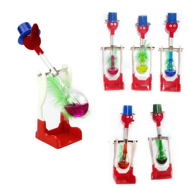b1b18dd7cf7 1 Pc Não-Parar de Beber Vidro Líquido Movimento Perpétuo Pássaro Sorte  Brinquedo De Mesa