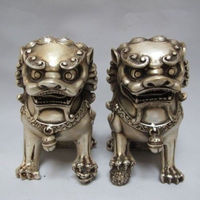 A Pair of Chinese Tibetan Silver guard Foo Dogs Lion statues
