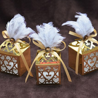 25pcs/lot Laser Hollow out Carving of Black and White Feather Gold Cardboard Candy Box Wedding Favors And Gifts Box Party Suppli