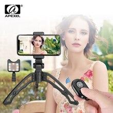 APEXEL trípode de mano elástico portátil 3 en 1, trípode de cámara remota con Bluetooth, de relleno para Selfie con luz Led, para todos los teléfonos inteligentes