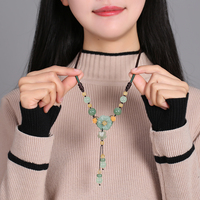 Ethnic style sweater chain long paragraph necklace accessories Dongling jade pendant personality wild decorations winter women