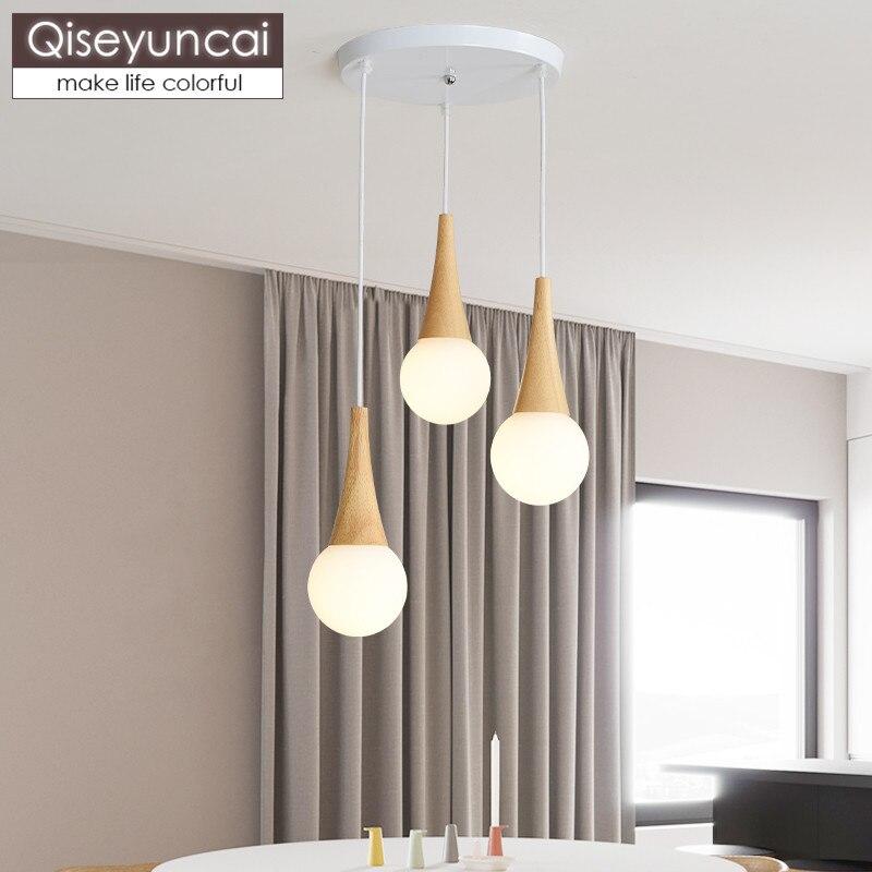 Qiseyuncai Nordic log three head combination restaurant chandelier modern minimalist bar glass ball magic bean lighting in Pendant Lights from Lights Lighting