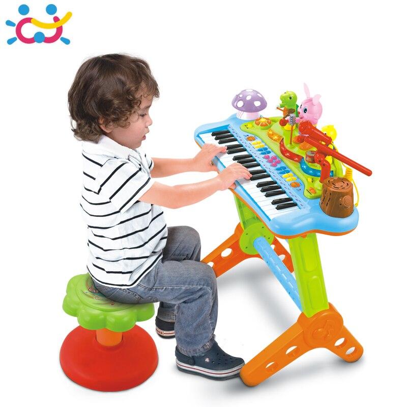Huile игрушки 669 дети музыкальные игрушки электронные клавишные музыкальные Органы С микрофоном, стул, учение свет ключи, танцы животного