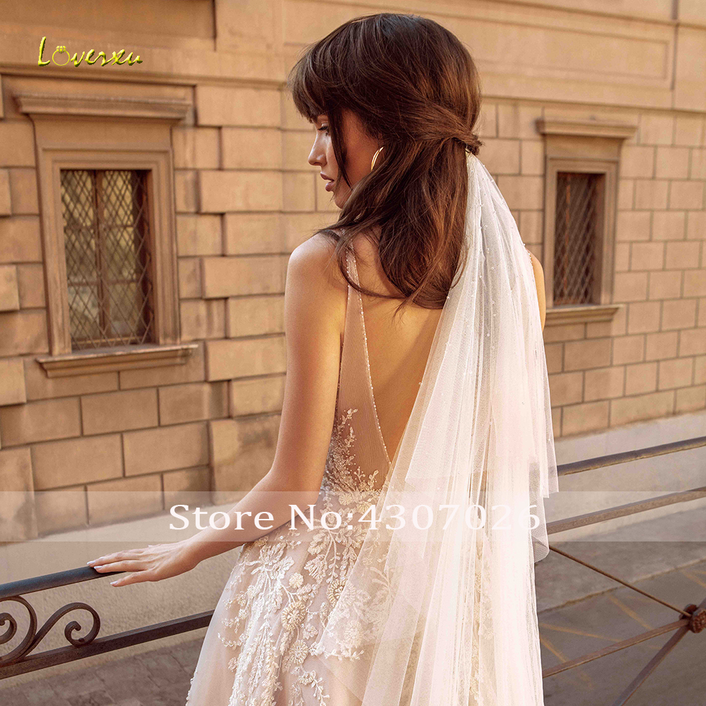 Image 2 - Loverxu V Neck A Line Wedding Dress Chic Applique Beading Tank Sleeve Backless Bride Dress Cathedral Train Bridal Gown Plus Size-in Wedding Dresses from Weddings & Events