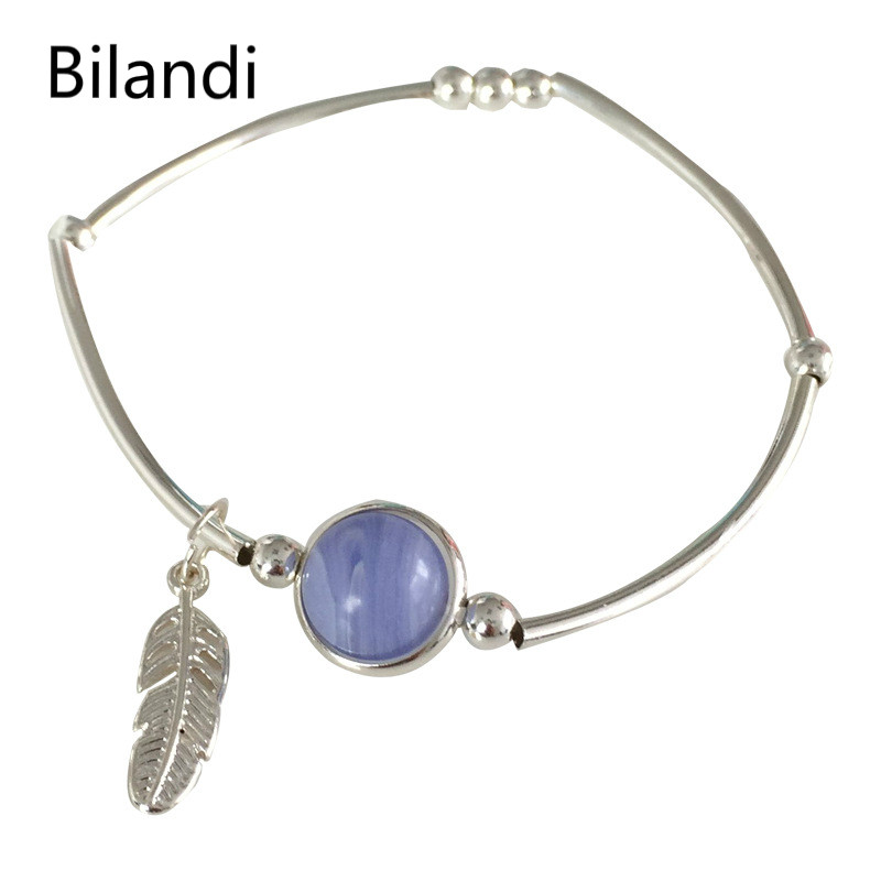 Strawberry Crystal Simple Feather Bracelet Irregular Pattern Ball Bracelet For Women in Charm Bracelets from Jewelry Accessories