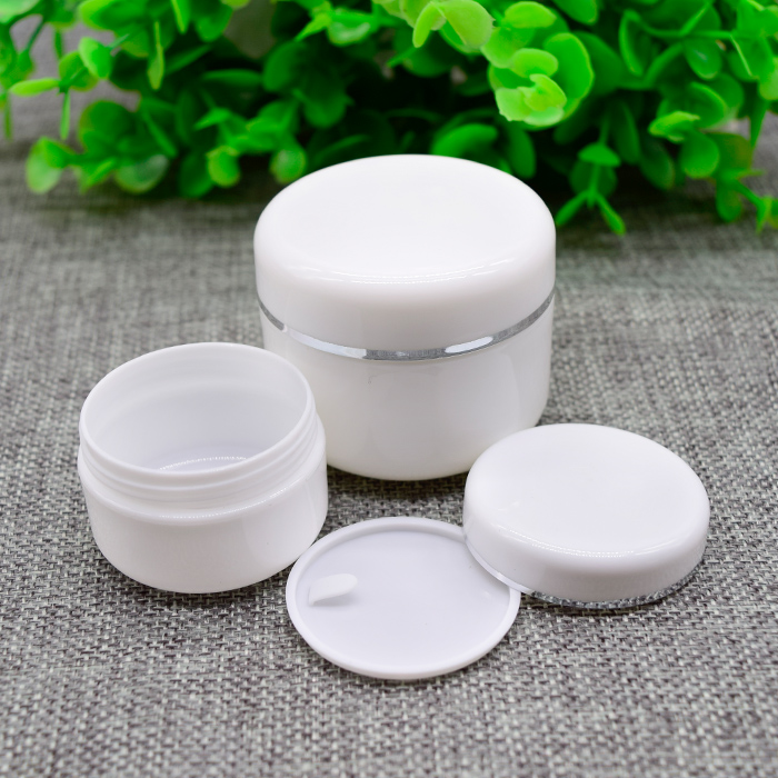 c0aa1905d6da US $40.31 |100pcs 50G white round cream bottle ,50g plastic cosmetic  container, wholesale white cream jar 50g with silver line-in Refillable  Bottles ...