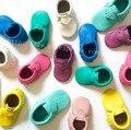 Frete grátis Nova Franja Arco Mocassins de Sola Macia Do Bebê Da Criança de Couro Genuíno Sapatos de Bebê Primeiro Walker Bebe Sapatos de Bebê Recém-nascido