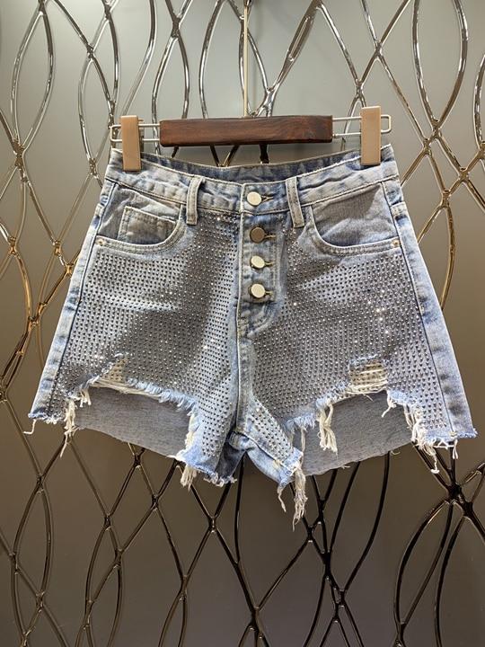 Las Mujeres Caliente Borde En Bolsillos Cortos Nuevas Pantalones De Salvaje Roto Perforación Mezclilla Calle Primavera 2019 wIUqfE7nT