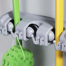 Hot Selling Plastic Kitchen Wall Mounted Hanger 4 Position Kitchen Storage Mop Broom Holder Tool