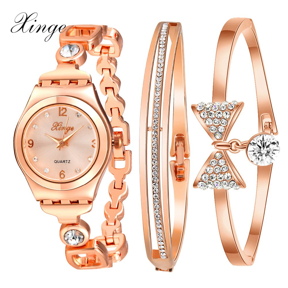 Prix pour Xinge Mode Femmes Bracelet Montre Rose et Argent Arc Alliage Bijoux Montre À Quartz Dames De Luxe Robe Montre Étanche Horloge