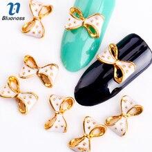 Blueness 10 шт Золотой Сплав Блеск 3d ногтей банты Искусство украшение с Стразы для ногтей амулеты на ногти принадлежности для салонов TN295