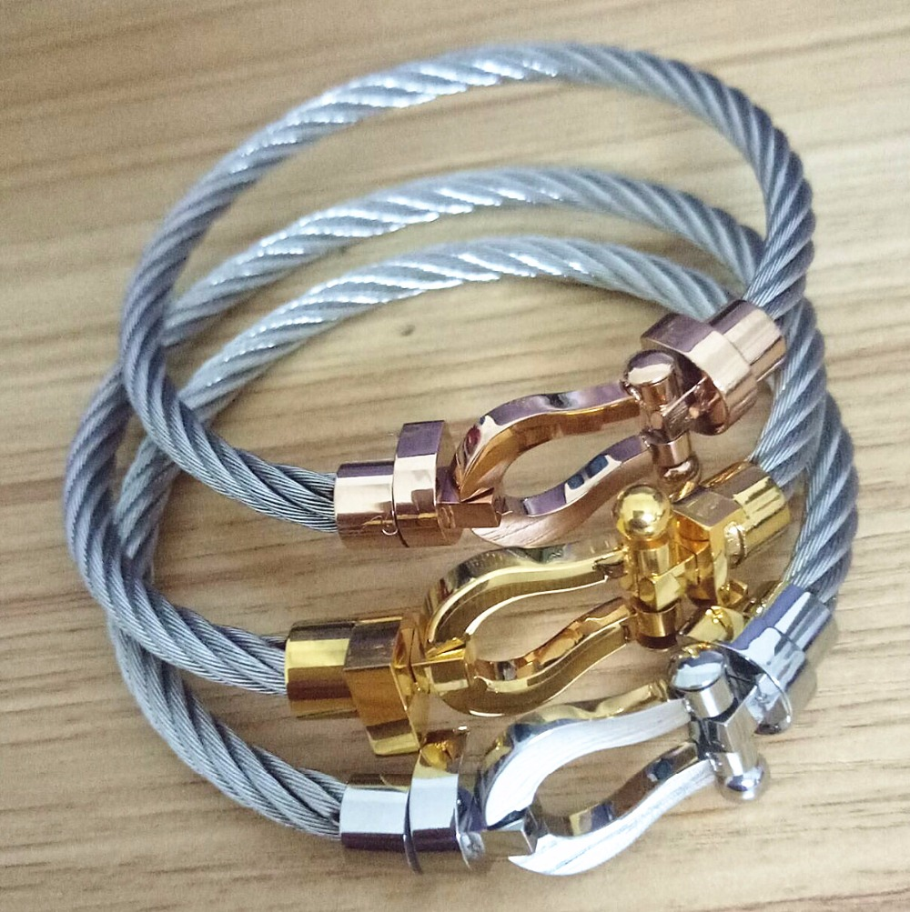 Latest designs stainless steel Twist Cable Wire Bangle Magnet ...