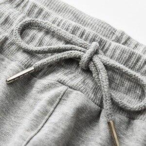 Image 5 - Los hombres de la primavera pantalón sudadera deportiva de talla grande gran 6XL 7XL 8XL 9XL negro Hombre Pantalones de cintura elástica simple Pantalón recto