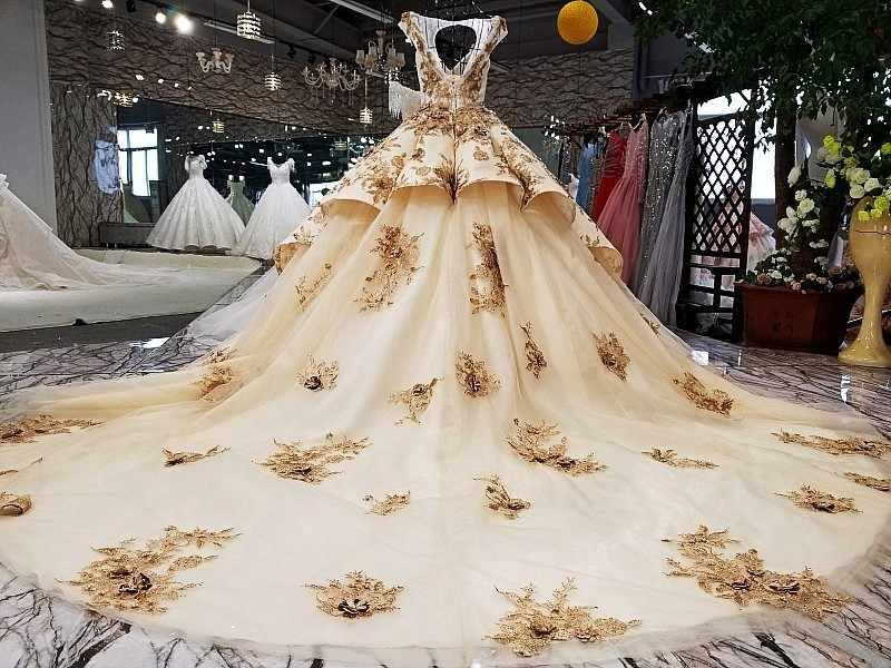 מזרח חדש עיצוב V-צוואר keyhole חזור כדור שמלת שרוולים זהב שמפניה צבע שמלת כלה 2020 עם רכבת