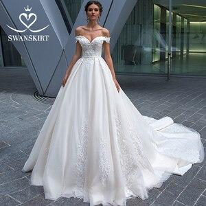 Image 1 - Vintage Beaded Lace Wedding Dress Appliques Off Shoulder A Line Princess Bride Gown Court Train Swanskirt F125 vestido de noiva