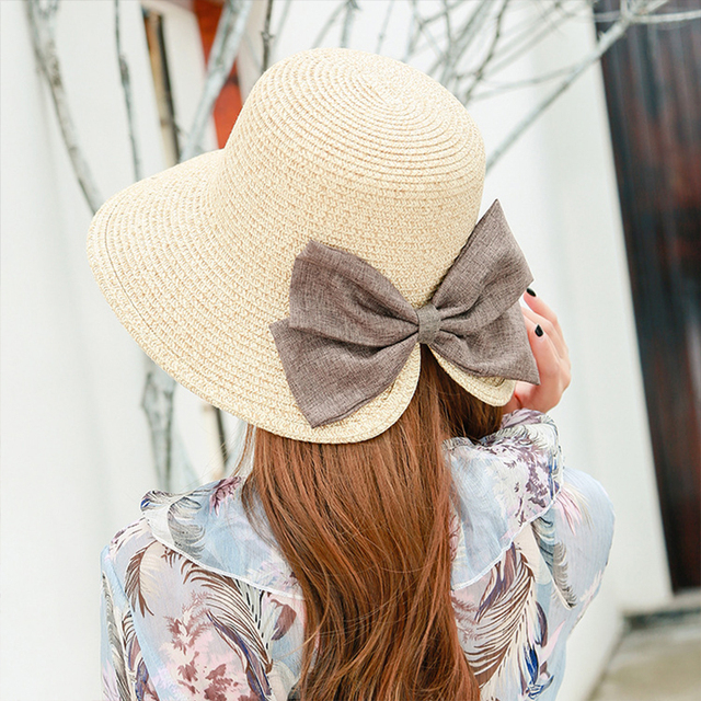 Summer fashion Men and women straw hat lightweight breathable cap bow sunscreen  beach caps outdoor sports 31e2f03a605e