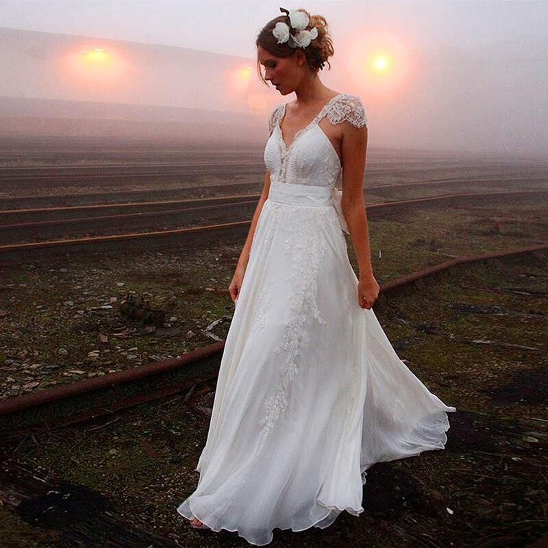03addc6a16 Venta caliente modesto primavera playa vestido de novia de encaje mangas  apliques Cristal verano vestidos de novia hochzeitskleid de en Vestidos de  novia de ...