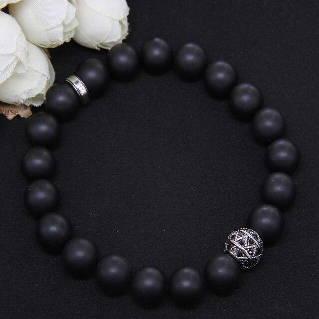 Фото матовый и зигзагообразный эластичный браслет thomas black obsidian цена