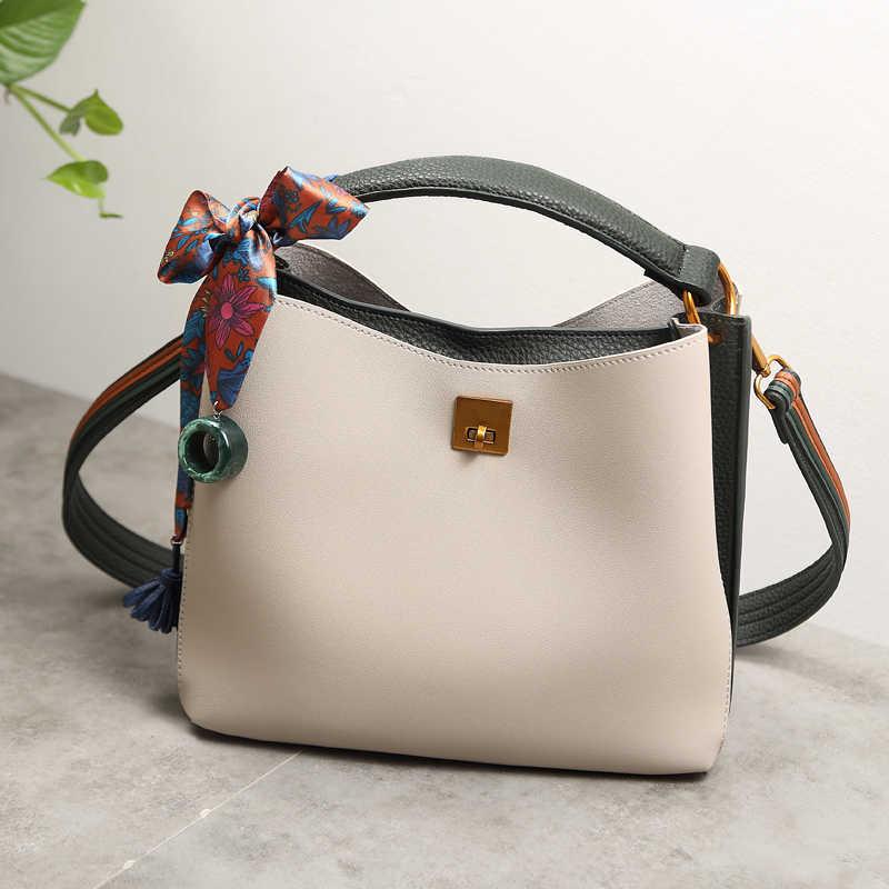 2019 デザイナーハンドバッグ高品質牛革女性の本革タッセル女性のメッセンジャーショルダークロスボディバッグ X95