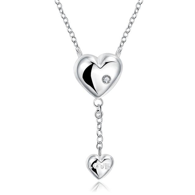 женское ожерелье с кулоном в виде сердца кристаллами фотография