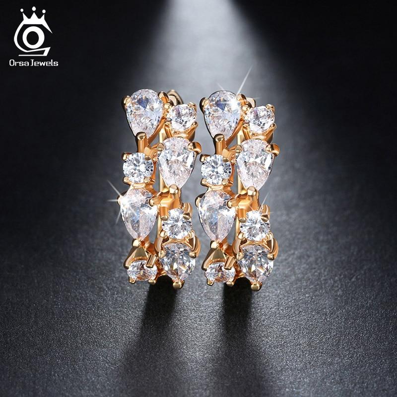 ORSA JEWELS Luxury 4 Piezas 0.3ct Encantador Clear Cubic Zirconia Stud Pendientes Color dorado para Fiesta Moda Mujer Joyería OME18