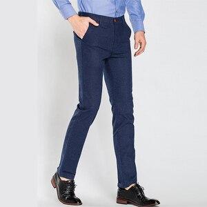 Image 5 - 2020 Winter New Men Warm Casual Pants Business Casual Elasticity Slim Thick Plus Velvet Trousers Male Brand Clothes Khaki Navy