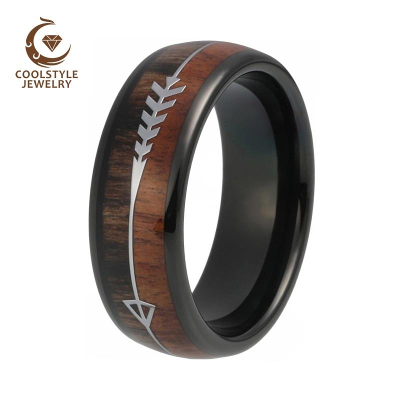 טבעת ממתכת בשילוב עץ וחריטה של חץ 3