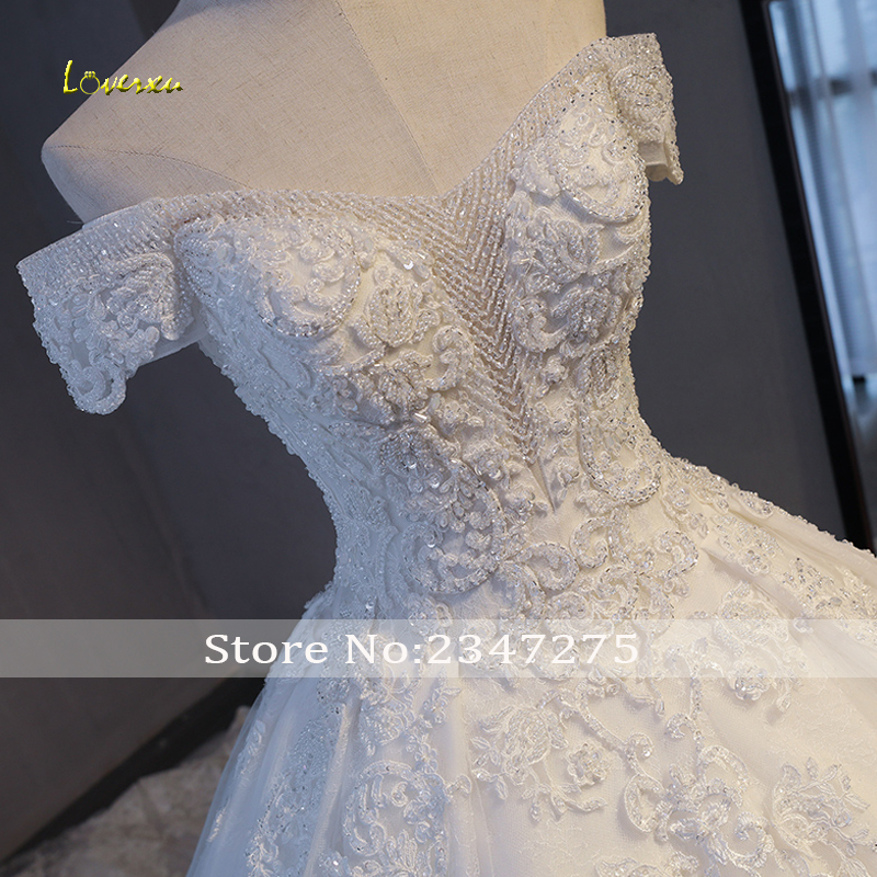 Image 4 - Loverxu Gorgeous Appliques Lace Chapel Train A Line Wedding Dress 2020 Luxury Beaded Boat Neck Sexy Bridal Gown Vestido de NoivaWedding Dresses   -