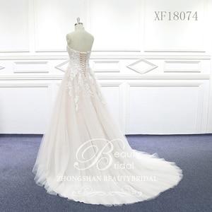 Image 3 - 100% נדל תמונות מתוק לב חתונת שמלות משפט רכבת חתונה Vestido תחרת כלה שמלה עם אגלי XF18074