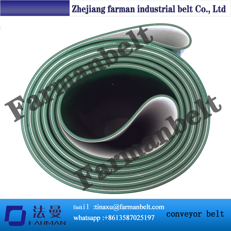Green PVC conveyor belt in roll with flat top
