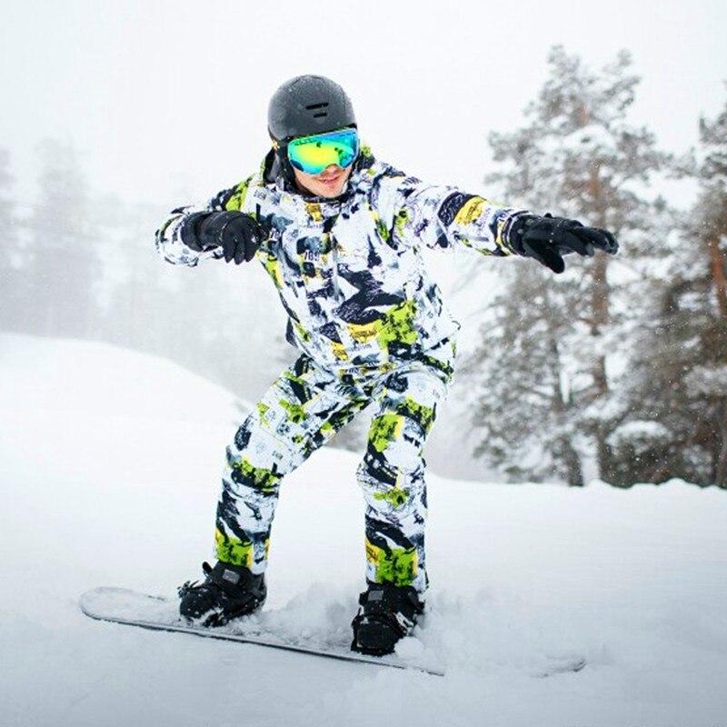 Nuevo 2018 trajes de esquí para hombre y mujer chaqueta + pantalones a prueba de agua transpirable térmico de algodón acolchado Snowboard impreso Graffiti traje de esquí