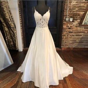 Image 1 - Elegant Wedding Dresses A line Appliques Spaghetti Straps Vestido De Noiva Illusion Bodice Backless White Wedding Gowns