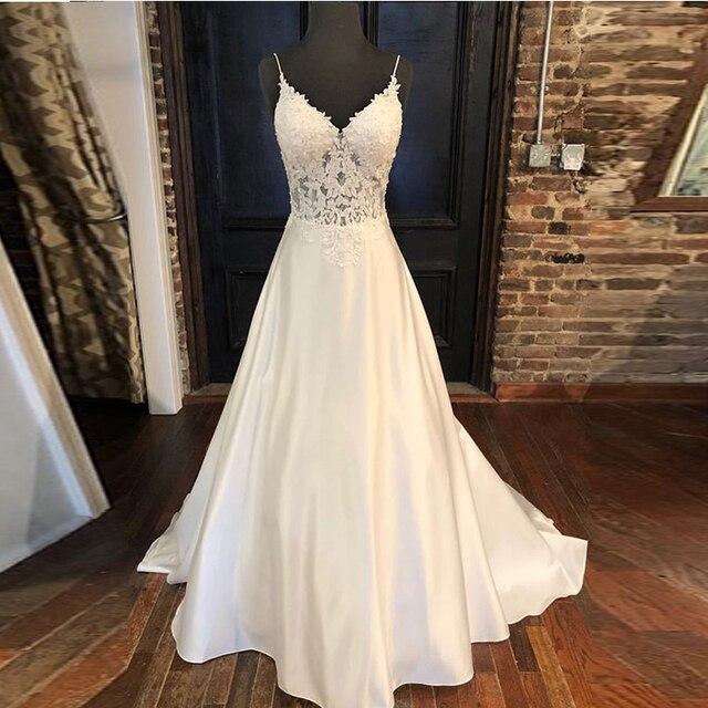 חתונה אלגנטית שמלות אונליין אפליקציות ספגטי רצועות Vestido דה Noiva אשליה מחוך ללא משענת לבן שמלות כלה