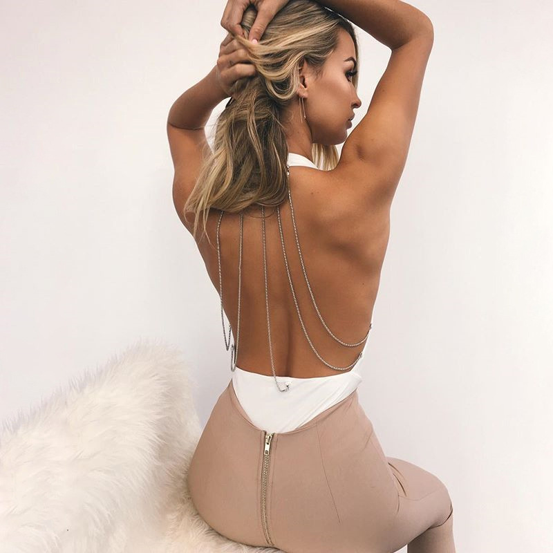 2a1fe68ad7 Sexy Backless Halter Jumpsuit Rompers Women Sleeveless Low Cut Bodysuit  Female Deep V Metal Chain White Black Jumpsuit Femme-in Bodysuits from  Women s ...