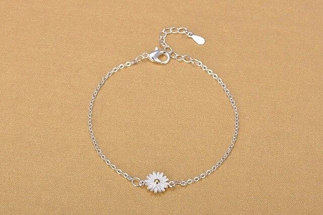 Фото женский браслет из серебра 925 пробы с подсолнухом цена