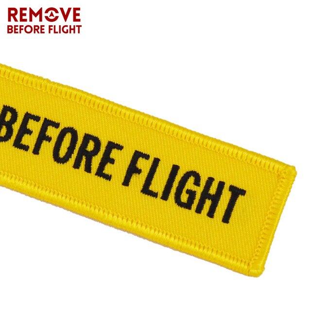Retirer avant le vol porte-clés llaveros choses importantes étiquette jaune broderie OEM clé chaîne bijoux Aviation cadeaux llavero mujer