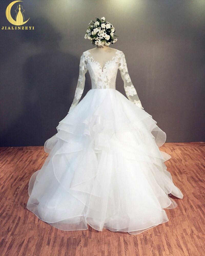 Reini reaalne näide Sexy pikkade varrukatega pits V kaela avatud seljapalliga kleit pruudi pulmakleitidest Pulmakleit