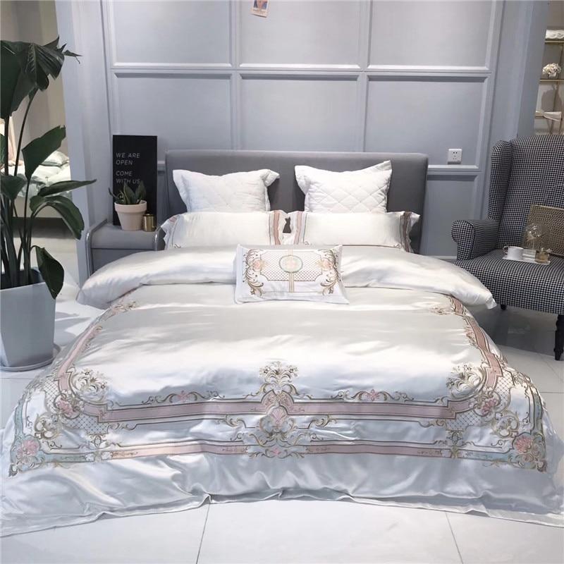 Blanc style Européen Royal De Luxe Broderie 100% soie Coton doux Ensemble de Literie Housse de Couette Taies D'oreiller drap de Lit Roi Reine Taille