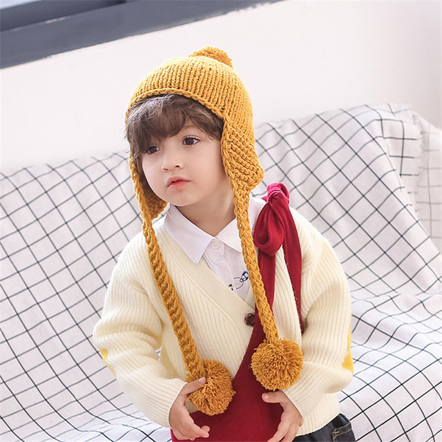 fa5362619d7 Autumn winter children s hats Large ball Knitted wool ear cap Hand-made  warm baby cover