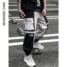 купить UNCLEDONJM Track Pants Man Color Block Pockets 2019 Autumn Hip Hop Fashion Harem Streetwear Fashion Jogger Casual Trousers 541W по цене 1880.29 рублей