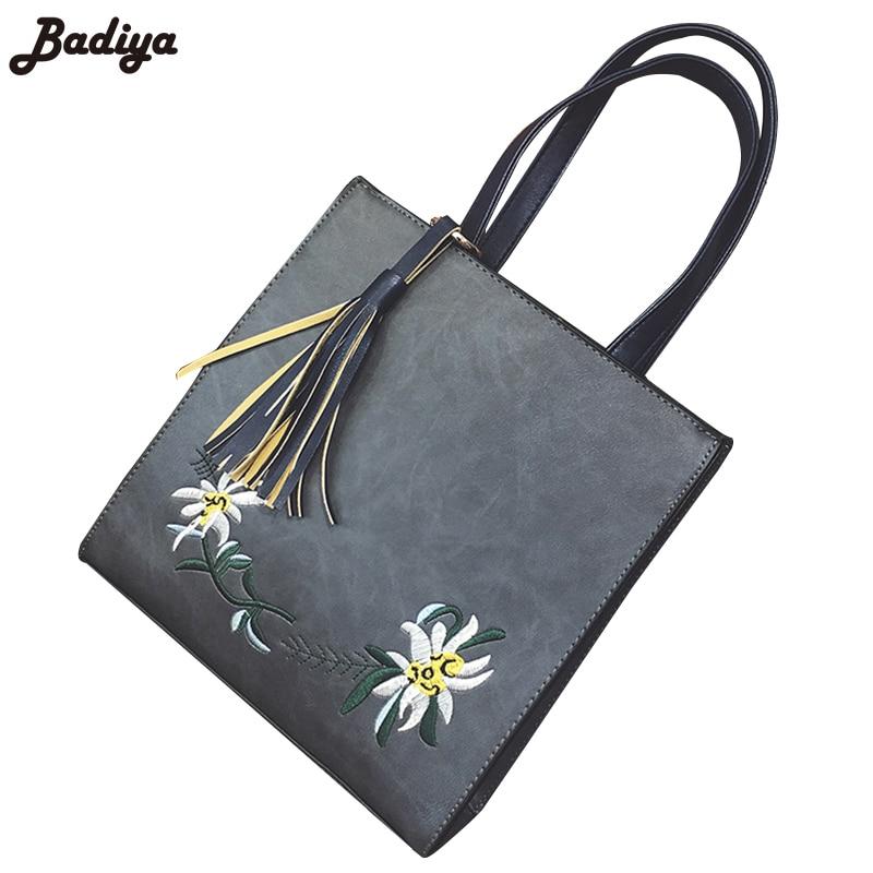 b35a7f7be Venta caliente de las mujeres clásicas del bolso Trunk flecos bolsa pu  cuero Amuletos flores de lujo casual bolsa cremallera Mujer moda bolsas