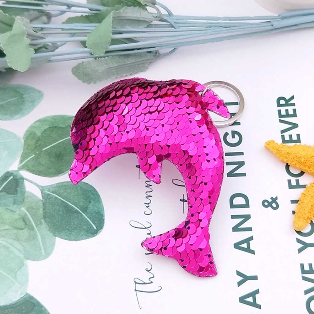 ... 10 8.5CM Color Changing Dolphin Keychain Cute Glitter Sequins Bag Pendant  Car Styling Key 425343ebc5dc