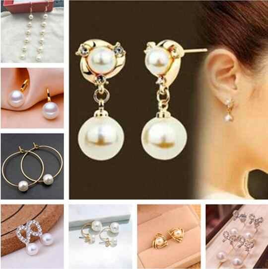 Regalo de fiesta de boda moda simple Aleación de cristal en forma de corazón arco imitación perla pendientes mujer exquisita joyería regalo